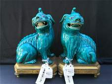 A PAIR OF TURQUOISE-GLAZED FIGURES OF LUDUAN