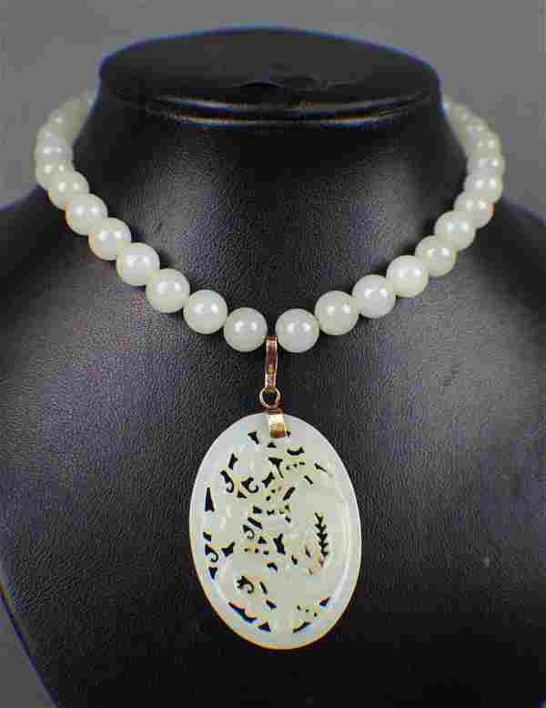 A Hetian White Suet Jade Necklace with a Pendant Carved