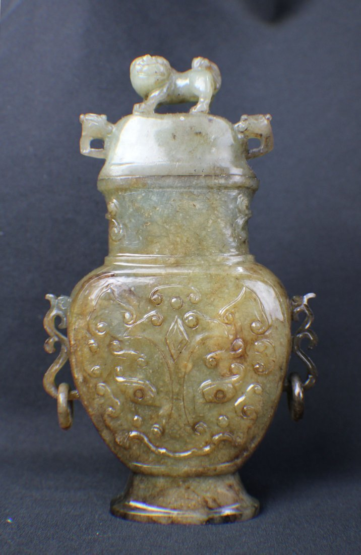 AN OLD JADE BOTTAL WITH A LION TOP from Ming Dynasty