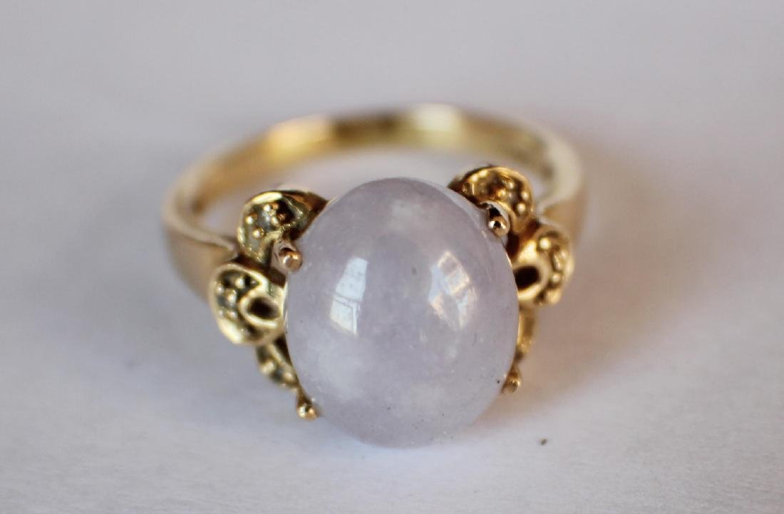 A 14K Gold Pupple Jadeite Ring