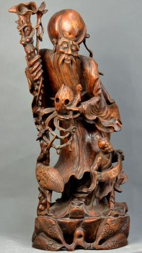 A Chinese Woodcarving of Longevity Star