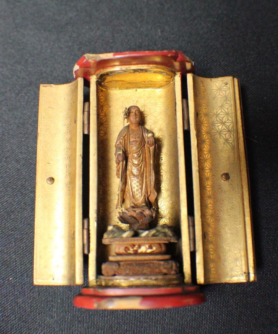 A Rosewood Pocket Buddha
