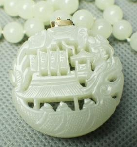 A HE TIAN ICE JADE IN OPENWORK CARVING OF SHIP WITH