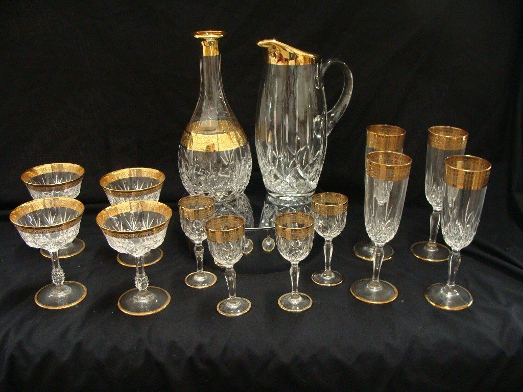 18: Gold Rimmed 53 pc set crystal with Wine Caraffe and