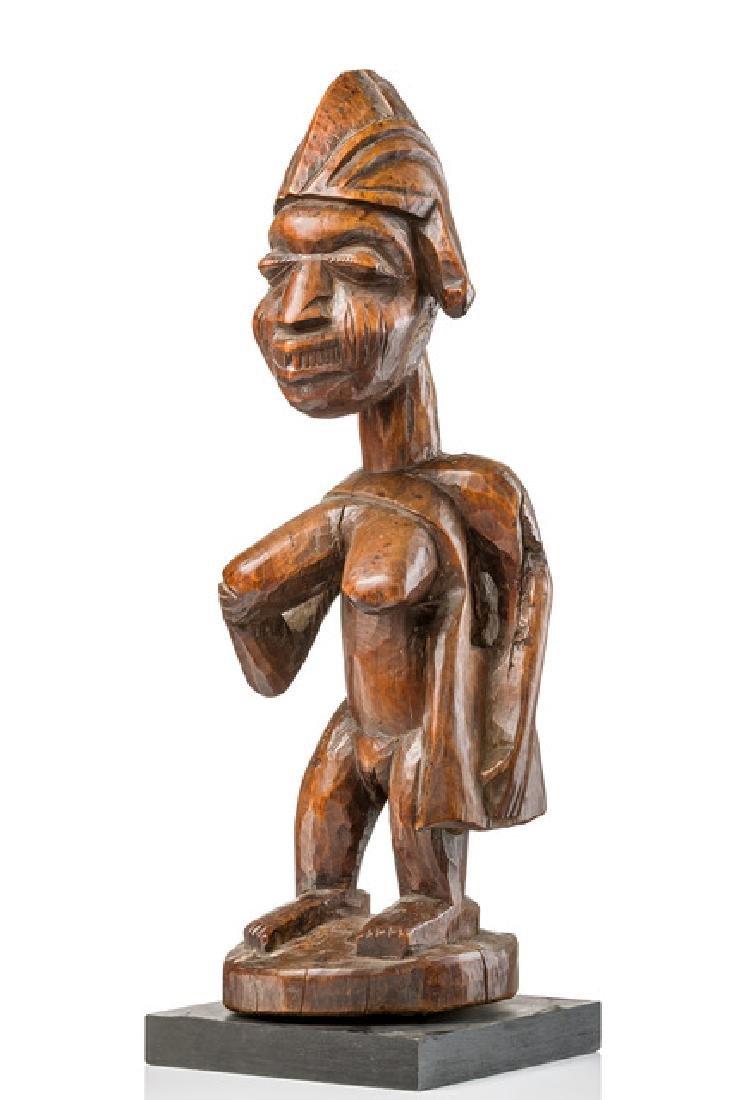 "Female ""shango"" shrine figure with shaman's bag ""laba"""