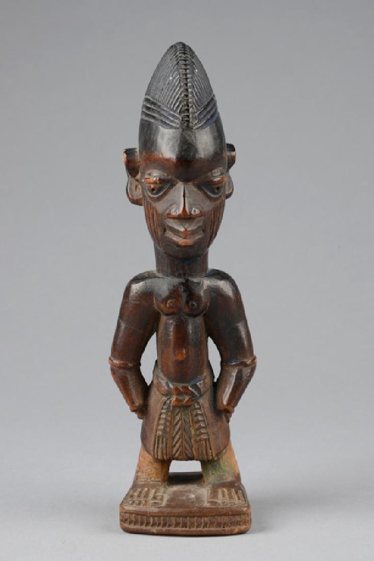 "Male twin figure ""ere ibeji"" and cowrie shell cape -"