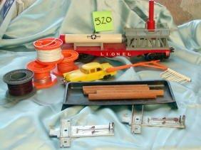 520: Lot of Lionel Accessories,Reels,Car,Logs, Missile
