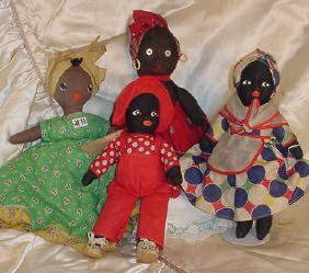 11: Four Black Cloth Dolls