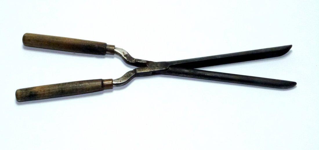 Fireplace Design fireplace tongs : metal curling tongs or hair iron.