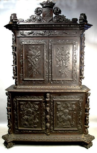 1014: 19th C. CONTINENTAL CARVED WALNUT CABINET