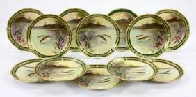 Twelve Limoges Plates