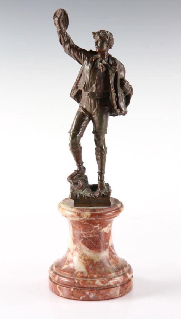 Bronze Statue of Man Wearing Hat