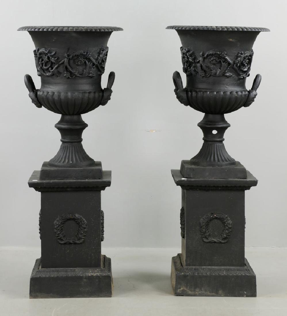 Pr of Classical Cast Iron Urns on Pedestals, Black