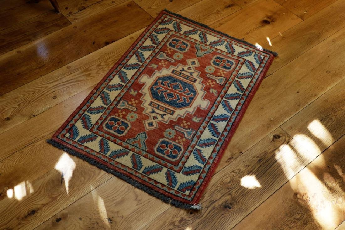 Semi-antique Small Kazak Rug