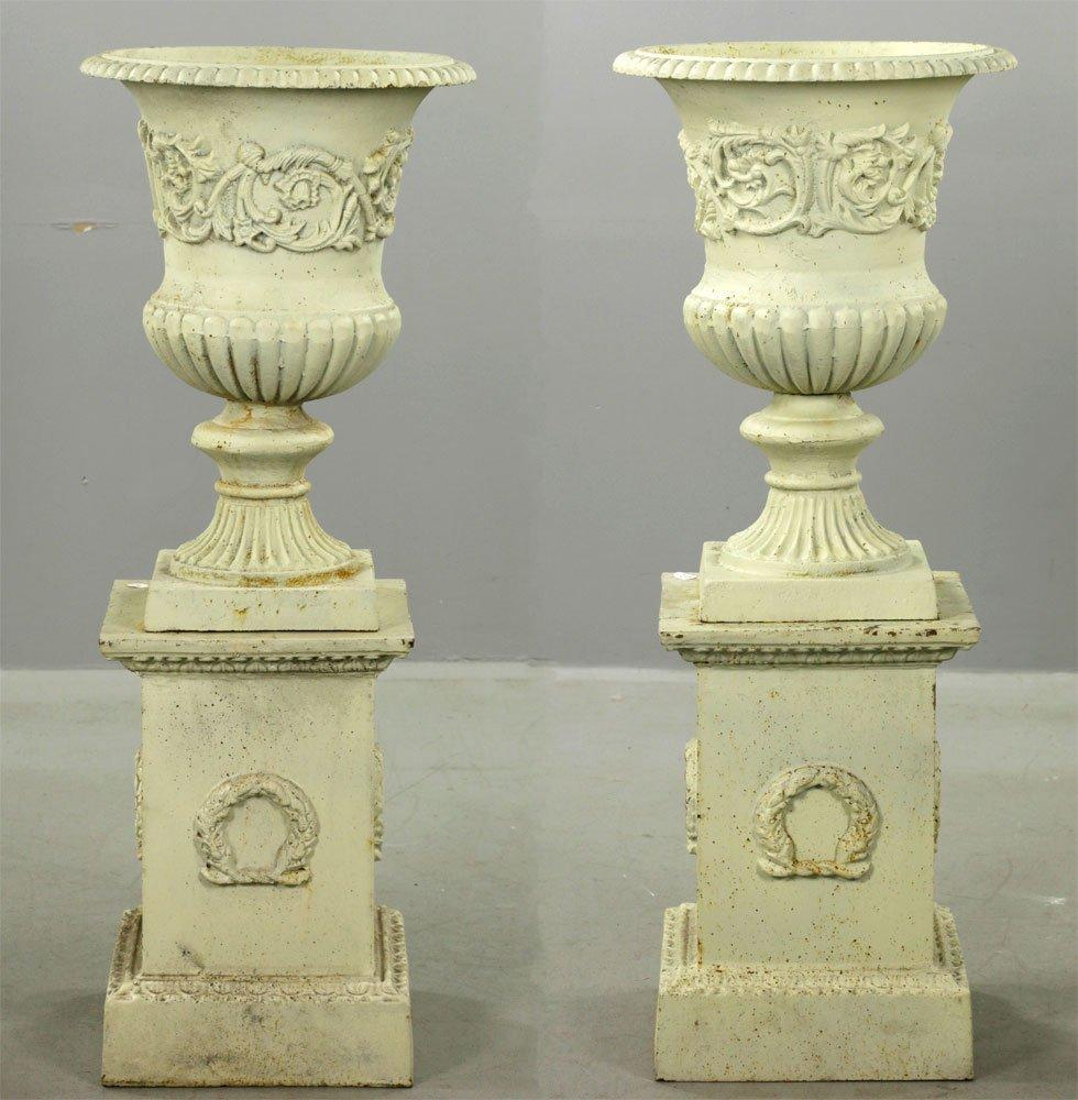 Pr of Classical Cast Iron Urns on Pedestals