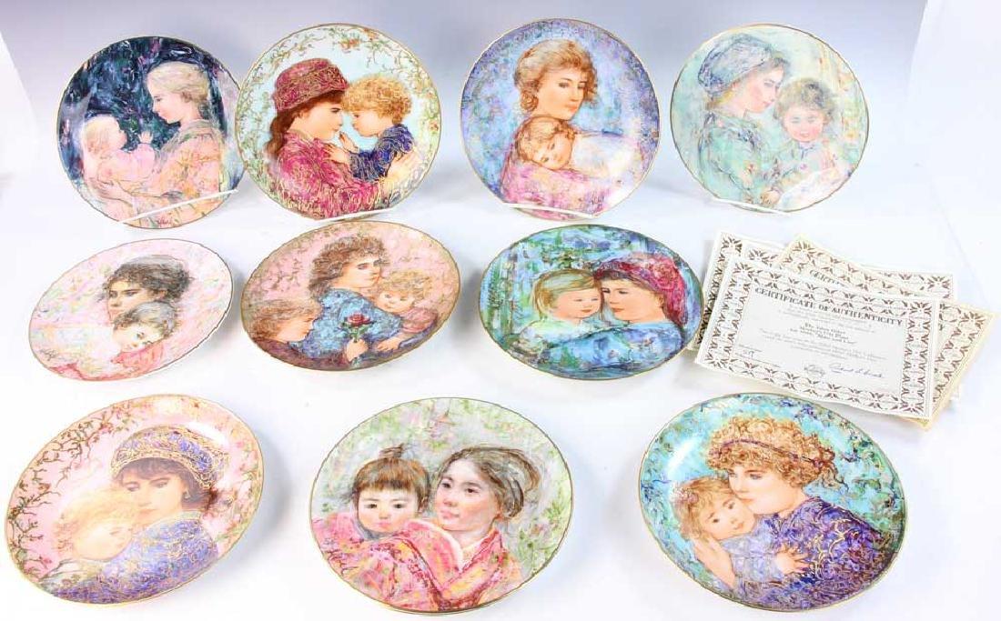 Eleven Edna Hibel Collector Plates