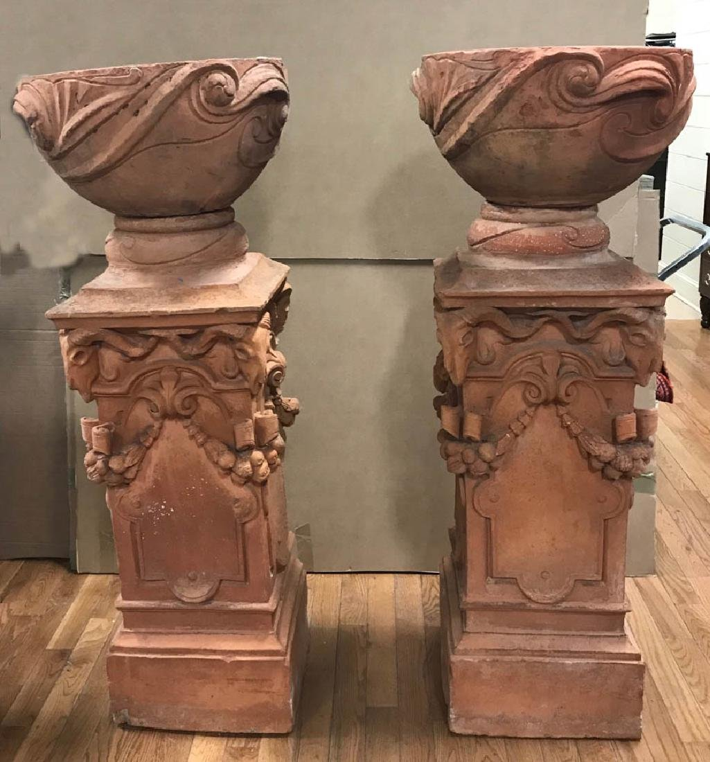 Pair of Victorian Terra Cotta Pedestals with Urns