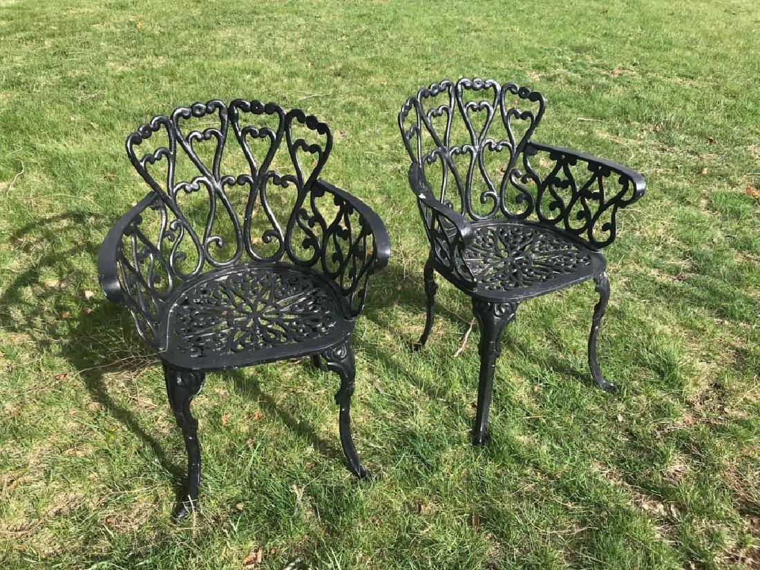 Pair of Black Cast Aluminum Armchairs