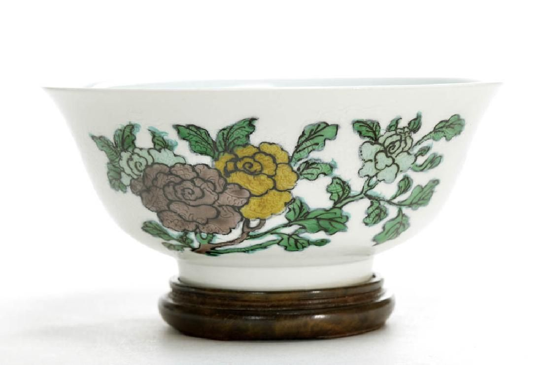 A Chinese Famille Verte Biscuit Dragon Bowl