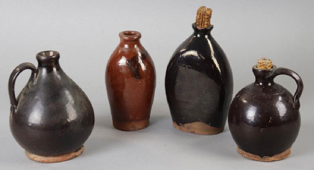 Four Early New England Redware Jugs