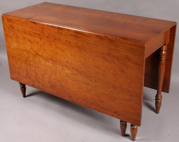329: 19TH CENTURY CHERRY DROP-LEAF TABLE