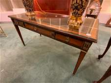 Regency style table desk with tooled leather top,