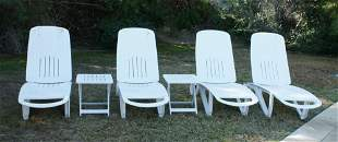 Group of Pool Patio Lounge Chairs and Tables