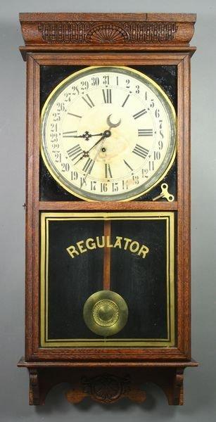 3007: Ingraham Regulator Calendar Oak Wall Clock