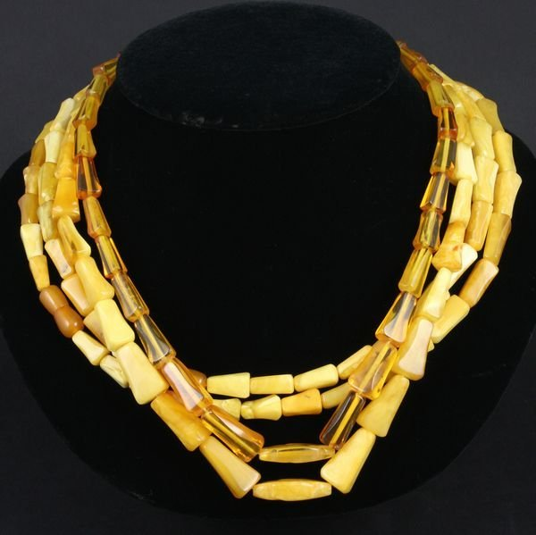 """4005: Group of four (4) amber necklaces, 20"""" l."""