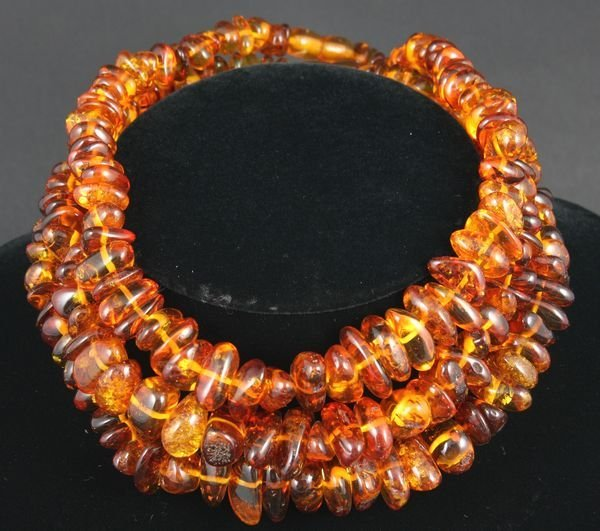 """4006: Group of three (3) amber necklaces, 16"""" l."""
