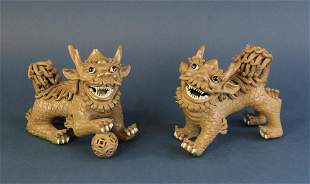 Pair of Pottery Foo Dogs