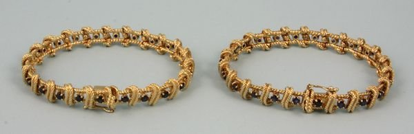 5018: Pair of Tiffany 14k yellow gold & sapphire bracel