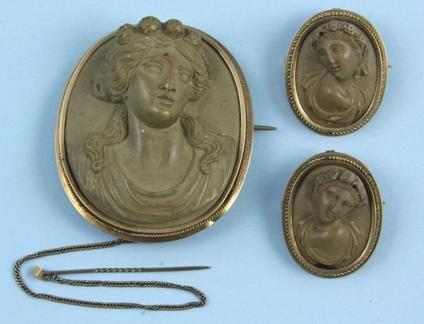 8003: Group of three cameo's, two set in 14k gold