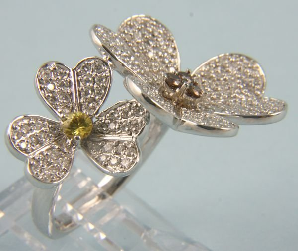 8011: Flower form canary and champagne diamond ring