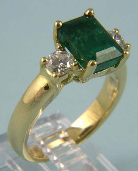 8018: Emerald, diamond, and 14k gold ring