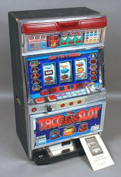 18: 20th C. Japanese Taco Slot Machine