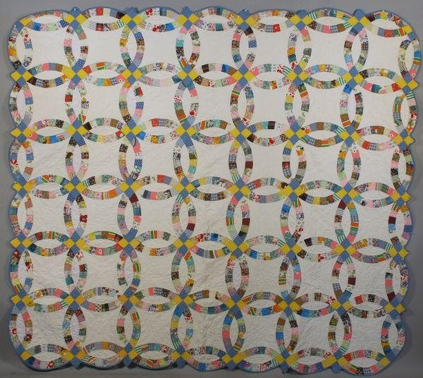 3023: Early 20th C. Double Wedding Ring Quilt