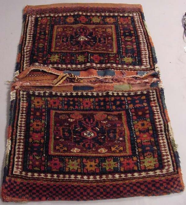35A: 19TH CENTURY PERSIAN SADDLEBAG RUG