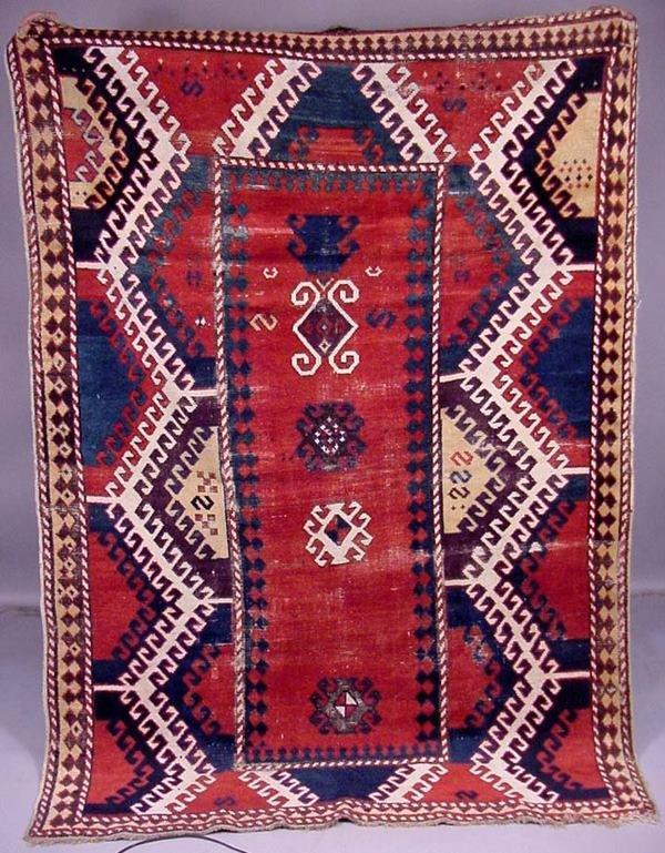 65A: 19TH CENTURY KAZAK RUG