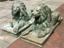 39: PAIR OF 20TH CENTURY BRONZE RECUMBENT LIONS