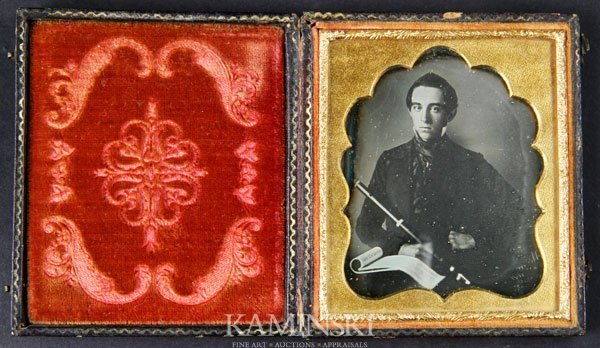 6015: Daguerreotype of Young Man with Instrument
