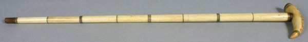 1005: 19TH C. BONE CANE WITH SCRIMSHAWED HANDLE