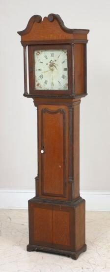 19: Early 1800's grandfather clock. Heavy brass movemen