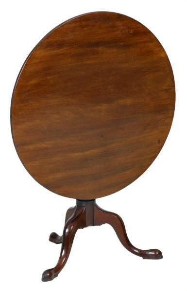419: Mid 1700's Queen Anne tilt top table. Solid mahoga