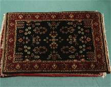 1099 Lot of three small handknotted wool rugs 21 x