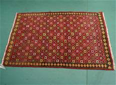 """1134: Persian handknotted wool rug, 3'2"""" x 4'11"""", roset"""