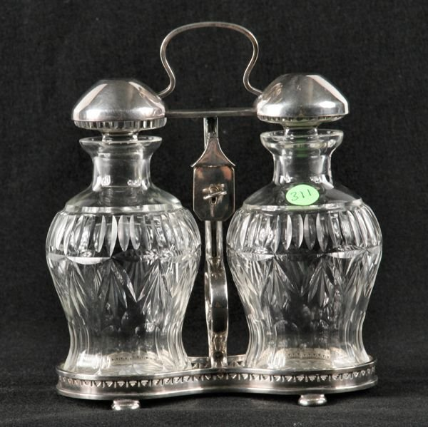 311: Pair of cut glass decanters in silverplate holder