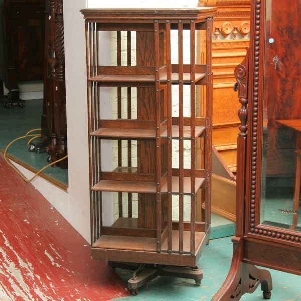 281: Unusual tall c1900 revolving bookcase, Danner, oak