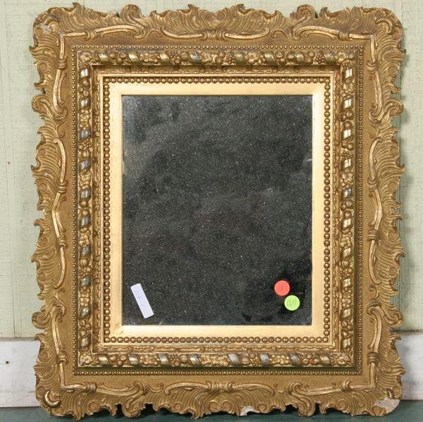 1018: Fine late 1800's gilt mirror, fruit/floral motif