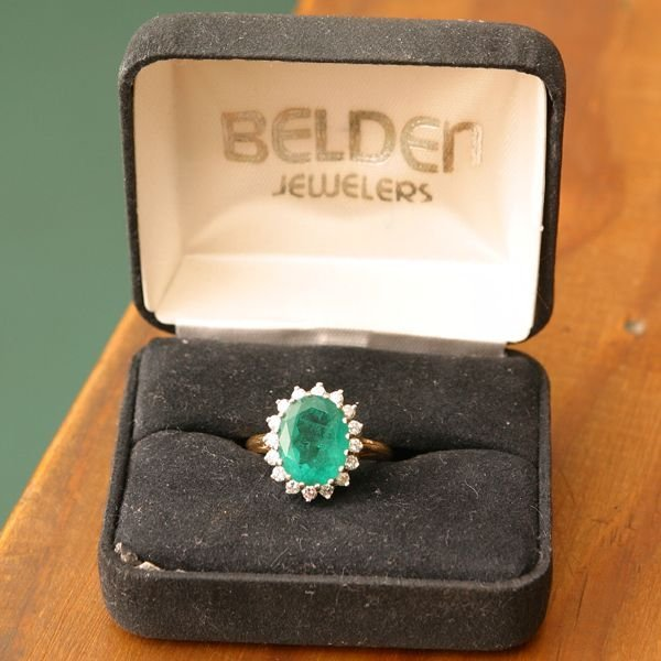 1071: Ladies emerald and diamond ring, 14kt yellow and